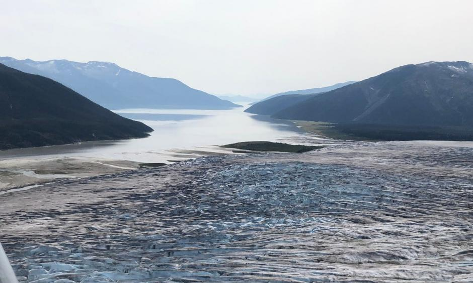The terminus of Taku Glacier and the Taku River are seen from an aircraft, looking southwest, on Aug. 2. Credit: James Brooks/ADN