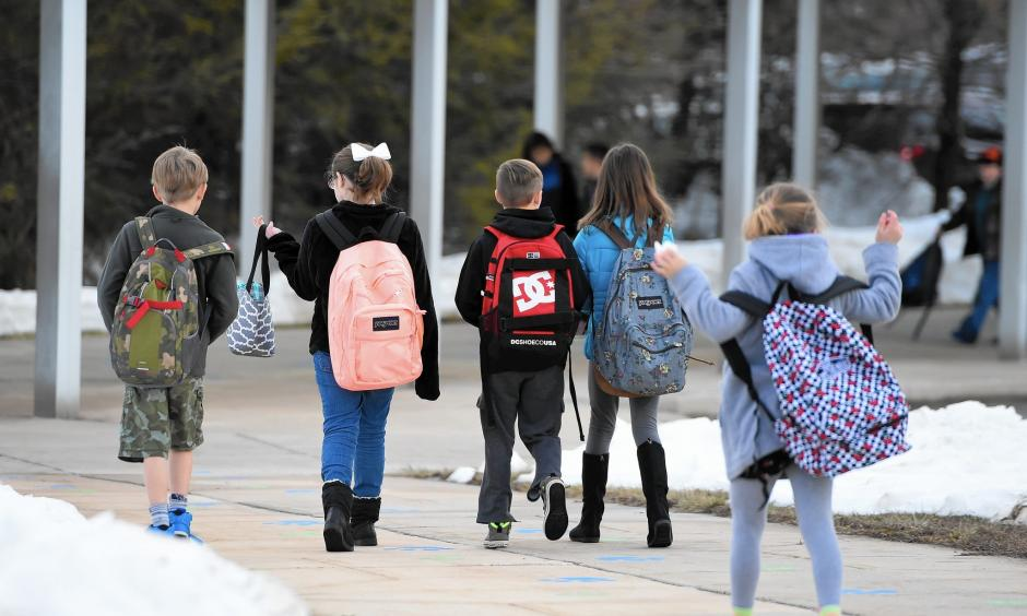 Students made their way into Forest Lakes Elementary School Monday morning to begin their day after a week long break because of last week's blizzard. Photo: Matt Button, Aegis Staff, Baltimore Sun