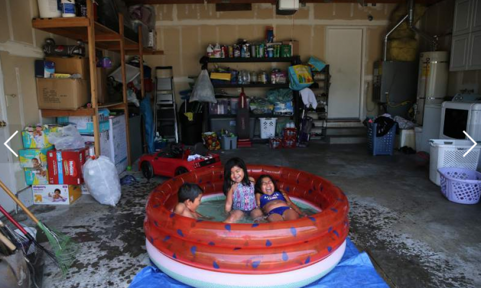 Sisters Nyla Herrera, 9, right, and Jaylah, 5, and their cousin Damon Knight, 6, swim in a kiddie pool in the girl's family garage to stay out of the heat of the direct sunlight in Santa Rosa on Monday, June 10, 2019. Photo: Beth Schlanker, The Press Democrat