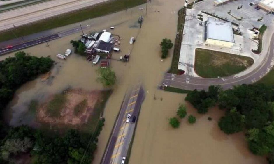 Flood waters cover the area of FM 1463 at IH-10 in Fort Bend County, Texas, U.S. April 19, 2016. Photo: Texas DOT-Houston, Handout via REUTERS