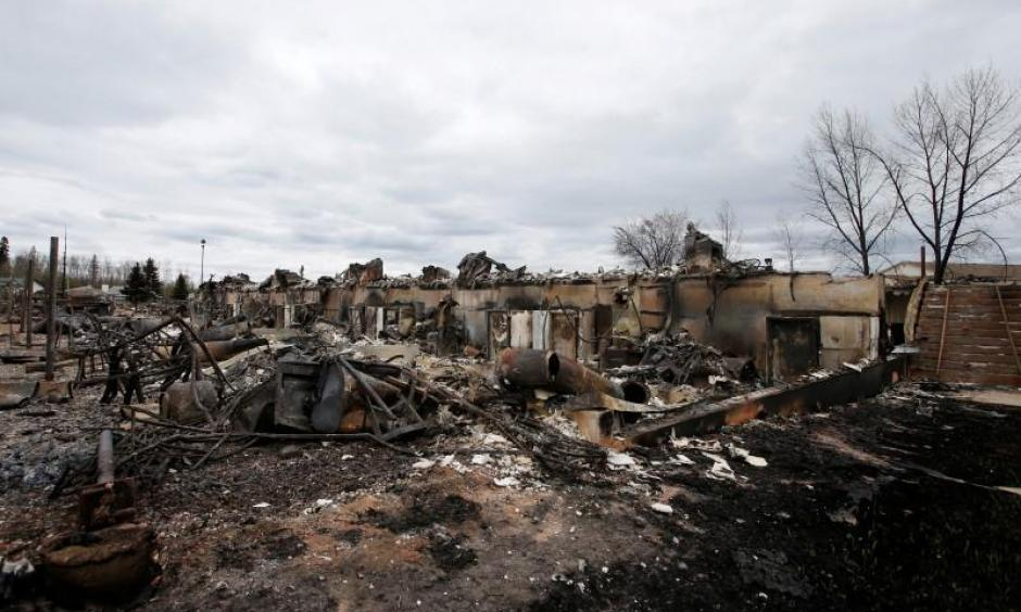 Burned out homes are pictured in the Abasand neighbourhood of Fort McMurray, Alberta, Canada, May 9, 2016 after wildfires forced the evacuation of the town. Photo: Chris Wattie, Reuters