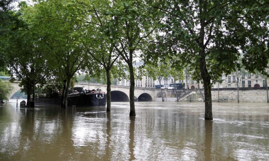 General view of the flooded river-side of the River Seine in central Paris with the 'Ile Saint-Louis' in the background. Photo: Charles Platiau