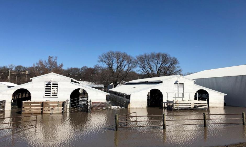 File photo: Paddocks at Washington County Fairgrounds are shown underwater due to flooding in Arlington, Nebraska, U.S., March 21, 2019. Photo: Humeyra Pamuk, Reuters