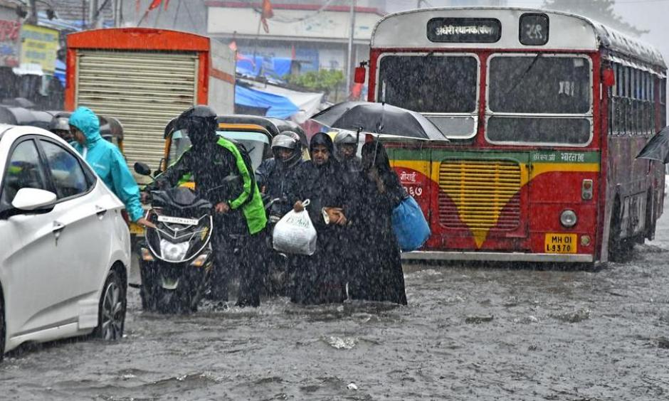 People walk through a flooded road at Andheri in Mumbai on Tuesday, August 29, 2017. Photo: Shashi S Kashyap
