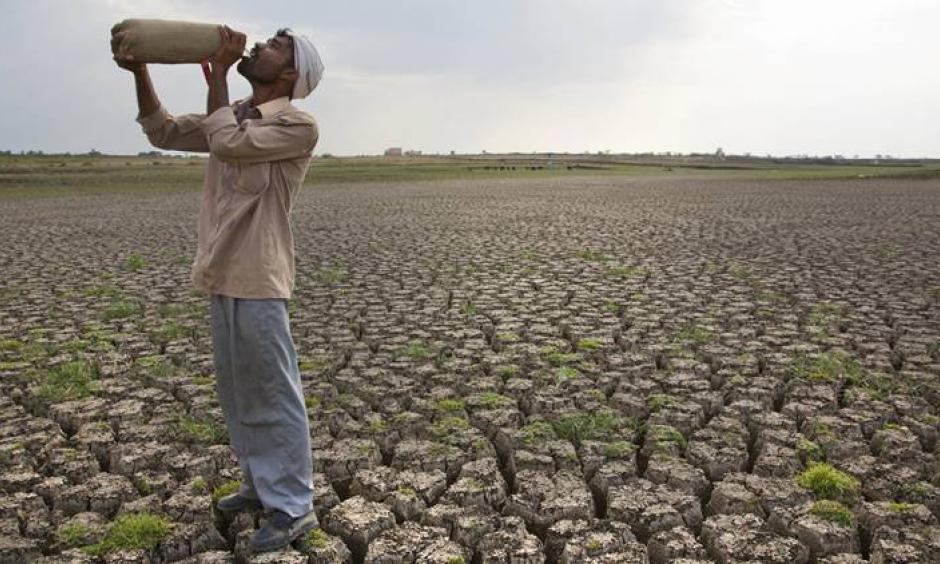 In this May 10, 2016, file photo, a Shepard drinks water on the dry bed of Manjara Dam, which supplies water to Latur and nearby villages in Marathwada region, in the Indian state of Maharashtra. Photo: Manish Swarup, AP