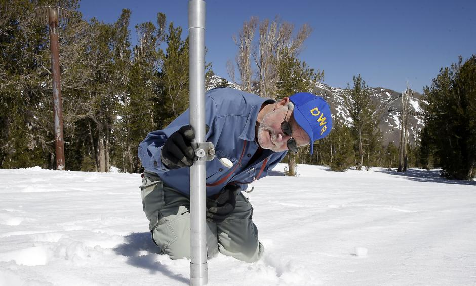 Frank Gehrke, chief of the California Cooperative Snow Surveys Program for the Department of Water Resources, checks the depth of the snow pack as he does a snow survey at Leavitt Lake near Bridgeport Calif. Photo: Rich Pedroncelli, Associated Press