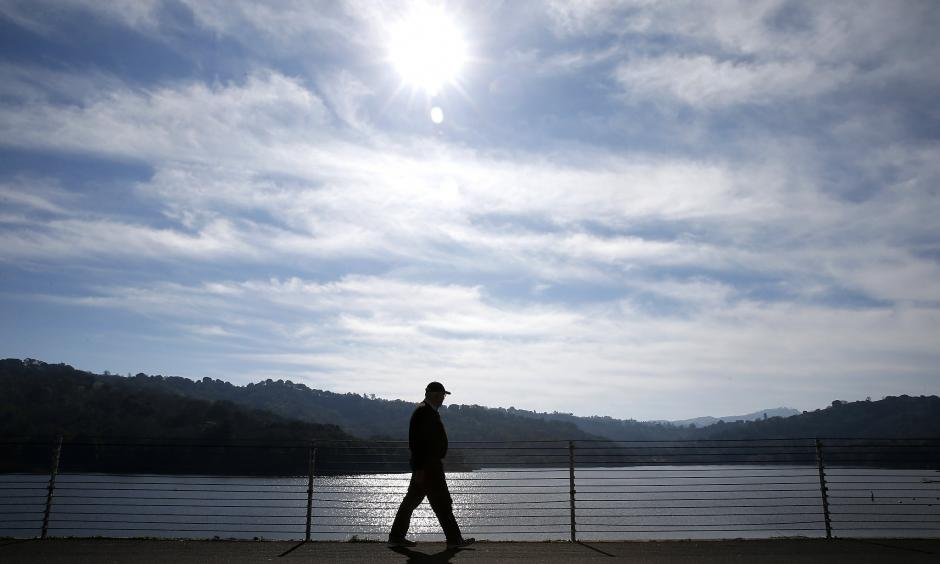 Michael Callow has an unseasonably warm day to enjoy one of his regular walks along the rim of Lafayette Reservoir in the East Bay. Photo: Paul Chinn, The Chronicle