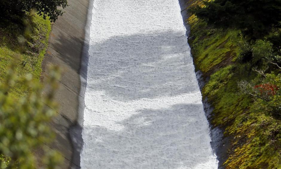 Water pours through the Bon Tempe Dam in Fairfax as rainfall totals surpass average. Photo: Scott Strazzante, The Chronicle