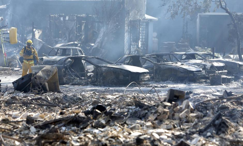 Burned out vehicles at an auto repair shop on Main Street during Clayton Fire in Lower Lake, Calif., on Monday, August 15, 2016. Photo: Scott Strazzante, The Chronicle