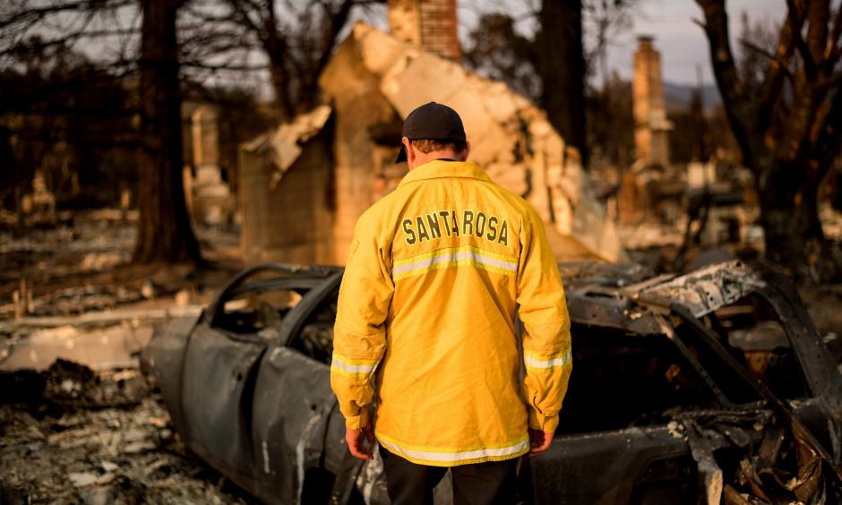 Santa Rosa Assistant Fire Marshal Paul Lowenthal walks through his Oxford Court residence, one of thousands of structures that were destroyed in the Wine Country fires last month. Photo: Noah Berger, Special to the Chronicle