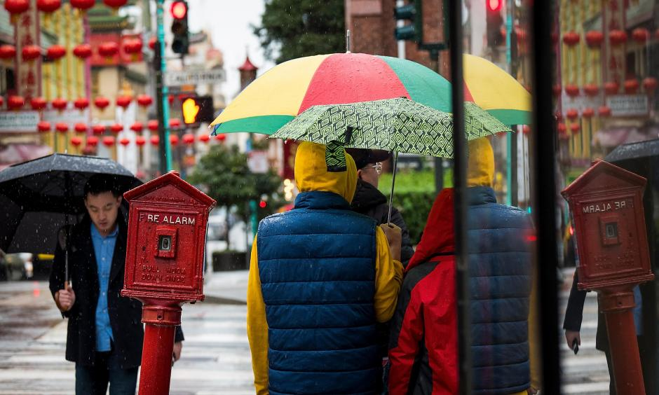 Pedestrians carry umbrellas while walking in the rain in downtown San Francisco on Friday, Feb. 8, 2019. Photo: David Paul Morris, special to the San Francisco Chronicle