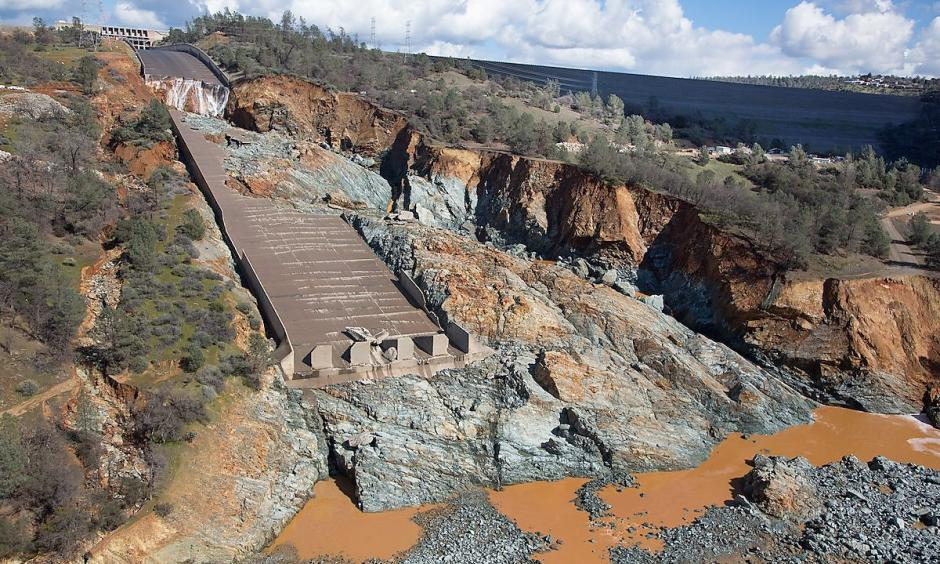 Damage to the spillway at the Oroville Dam is depicted in a photo released by the California Department of Water Resources on Feb. 28, 2017. Credit: CA Dept of Water Resources