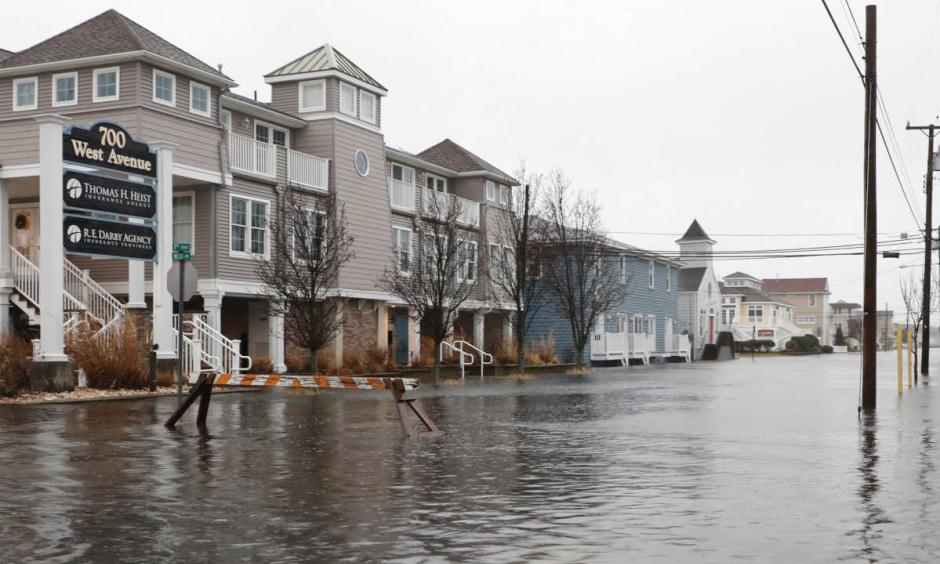 Flood waters at 7th Street and West Avenue in Ocean City, N.J., almost stretch from bay to ocean Monday during high tide. Photo: Thomas E. Briglia
