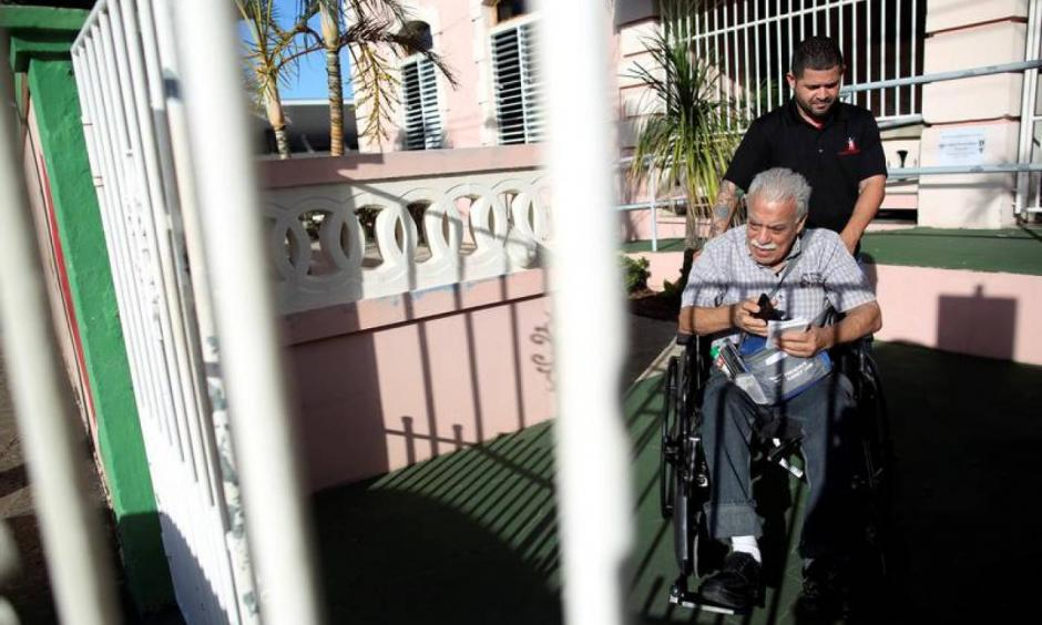 Nicky Sanchez Quiles, 71, a resident of the San Rafael nursing home and a dialysis patient, is taken to a hospital in Arecibo, Puerto Rico February 14, 2018. Photo: Alvin Baez, Reuters