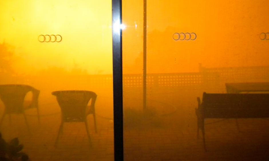 An orange smoke cloud fills Paula Tose's loungeroom window as the Sampson Flat bushfire roars up the valley and towards her home. Photo: Paula Tose