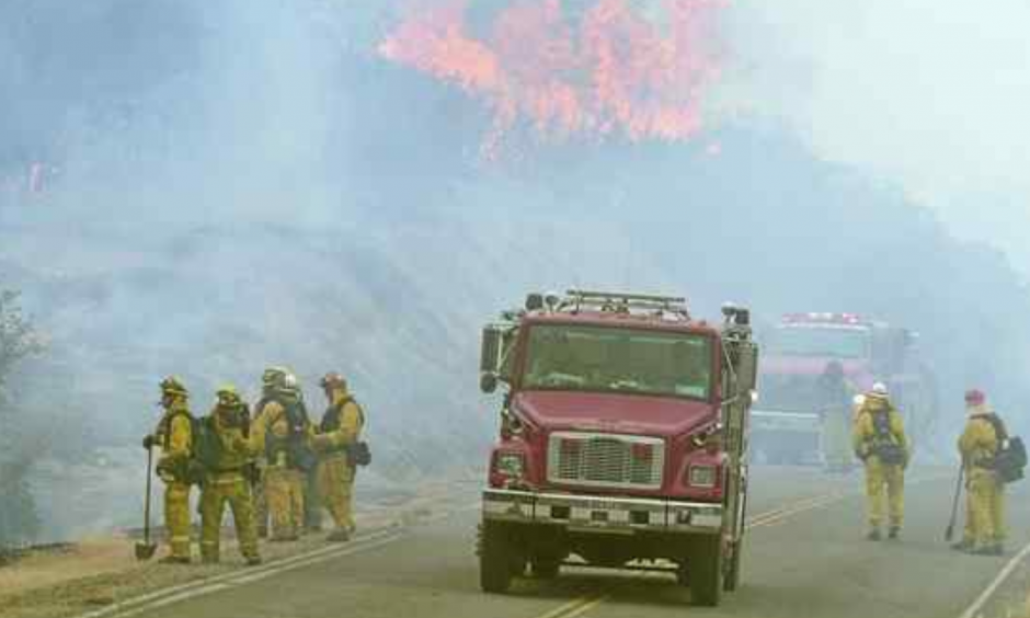 Firefighters perform a firing operation along Interlake Road while battling the Chimney Fire in southern Monterey County on Tuesday. The fire started south of Nacimiento Reservoir in San Luis Obispo County. Photo: David Royal, Monterey Herald