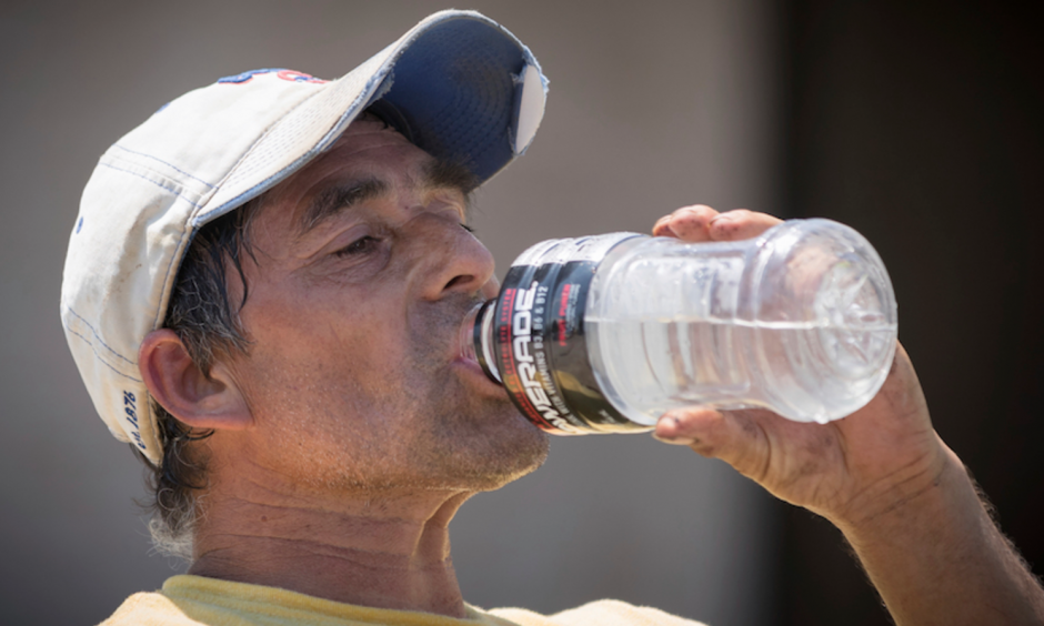 Delfino Villagomez drinks water while laying asphalt on Thursday, July 20, 2017, in Omaha, Neb. Temperatures hit 98°F in Omaha on Thursday after a morning low of 80°F. Photo: Kent Sievers, Omaha World-Herald via AP