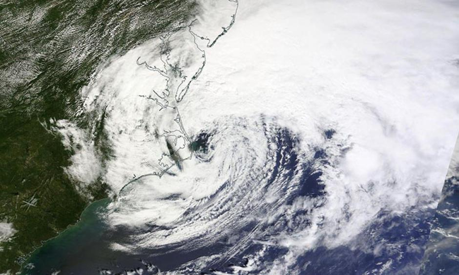 MODIS visible satellite image of Hermine taken at 12:30 pm EDT September 3, 2016. At the time, Hermine was a post-tropical cyclone with top sustained winds of 70 mph. Note the asymmetric shape of the storm, with a comma-like configuration, instead of circular. Image: NASA