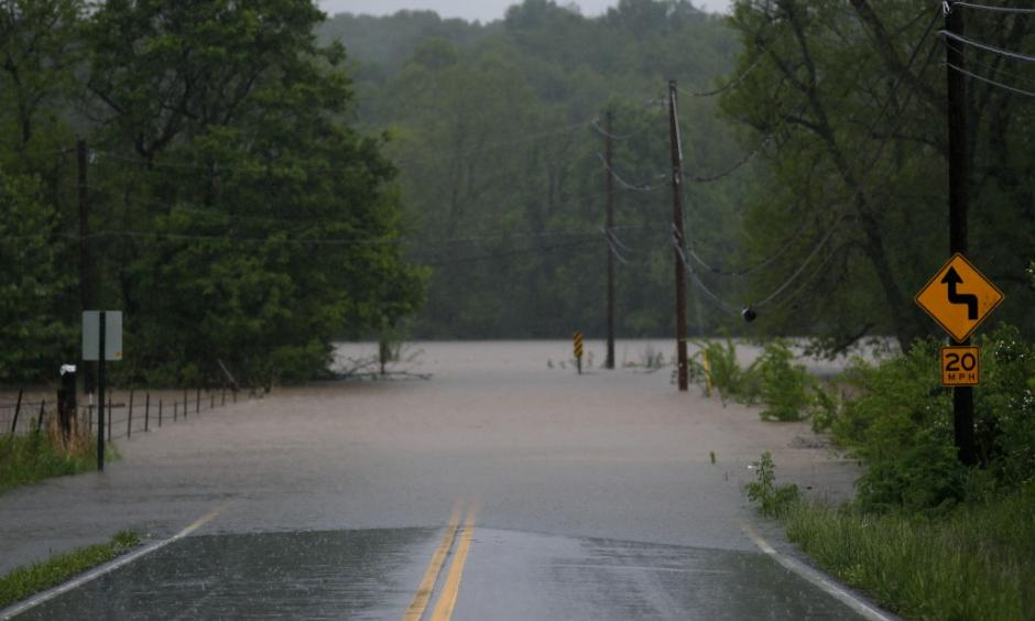 Water from the James River floods onto Farm Road 164 in Springfield, Mo., on Saturday. Photo: Nathan Papes, The Springfield News-Leader via Associated Press