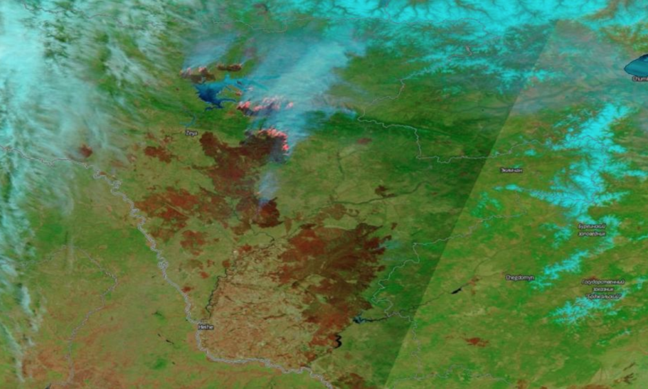 This false-color image acquired May 9, 2018 by the Moderate Resolution Imaging Spectroradiometer (MODIS) aboard NASA's Terra satellite shows wildfires burning in Siberia, in orange. Burn scars from these wildfires can be seen in brown. Image: NASA