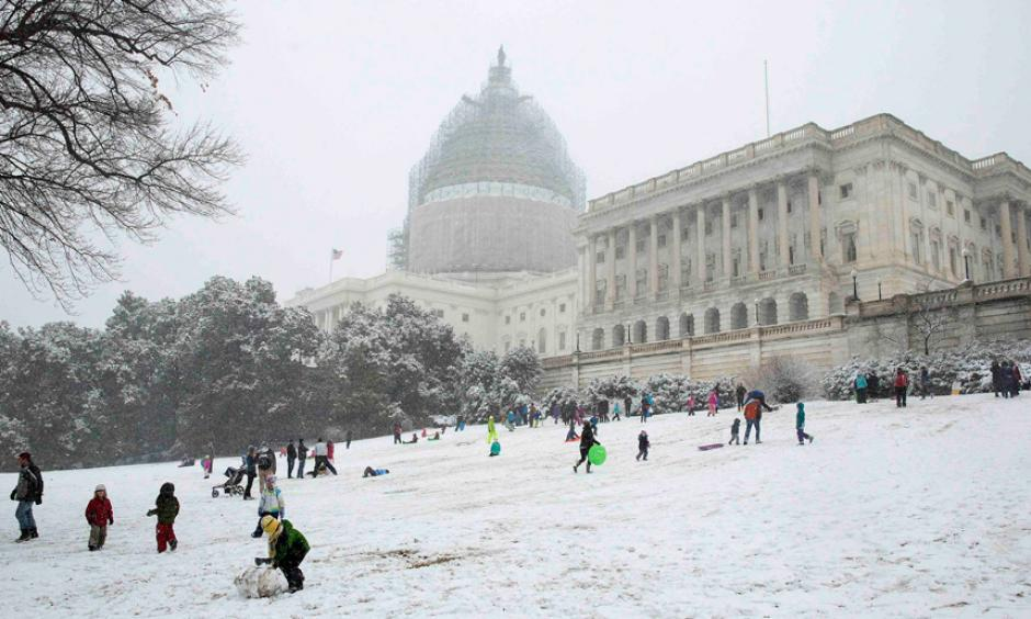 Children sled on the west lawn of the U.S. Capitol during a snow storm in Washington. Photo: Reuters