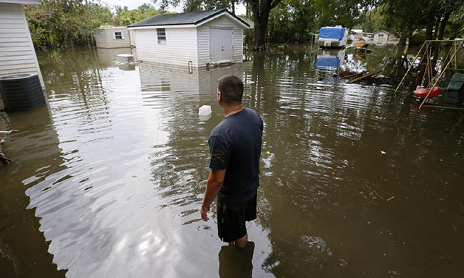 Chris Landaiche looking out to his flooded backyard in Sorrento, Louisiana, on Sunday. Photo: Jonathan Bachman, Reuters