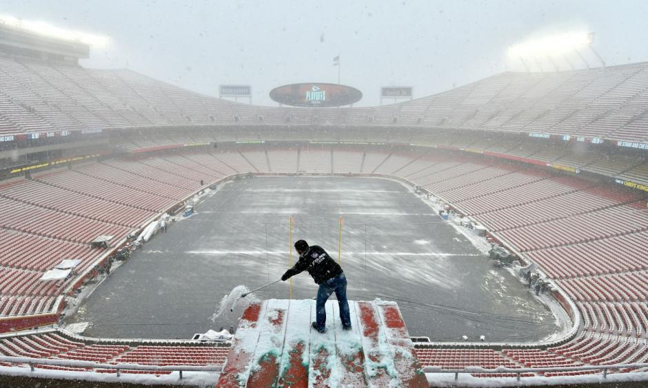Clearing snow ahead of the Kansas Chiefs playoff game last weekend. The coming weekend's game promises to be even colder. Photo: AP
