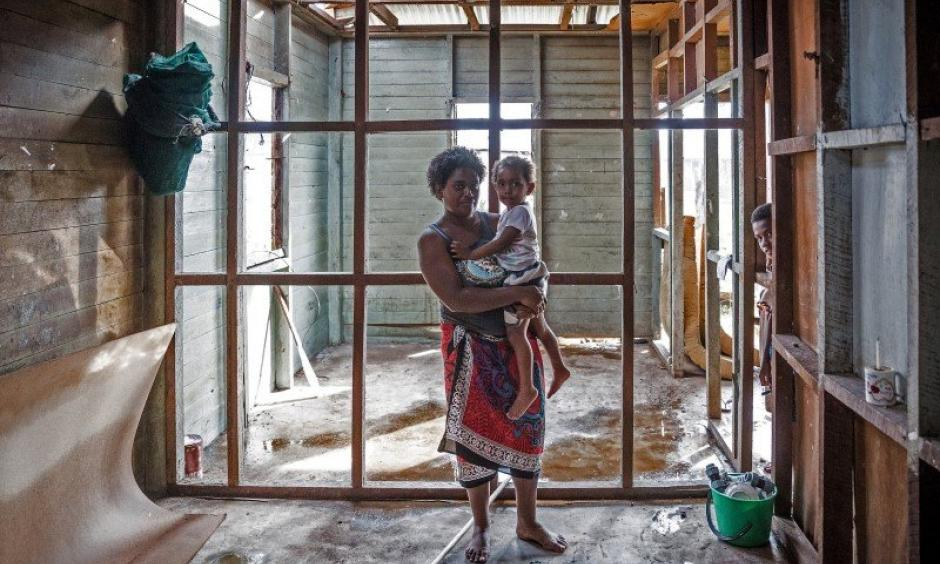 Kolora, 26, holds her daughter Semaima, 2, in what is left of her home in the aftermath of Tropical Cyclone Winston in Rakiraki district in Ra province of Fiji. Photo: UNICE