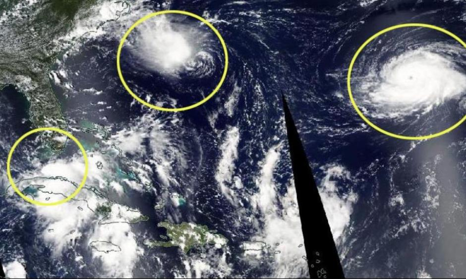 Circled on the satellite image are the three active Atlantic tropical cyclones on Sunday. Tropical Depression Nine (left), Tropical Depression Eight (center) and Hurricane Gaston (right). Image: The Weather Channel, NASA