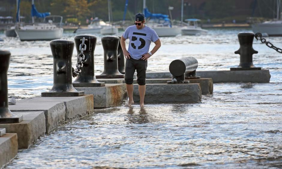 Andrew Dzurovcik was visiting Boston from Chicago when he spotted the high tides at Long Wharf. Photo: The Boston Globe