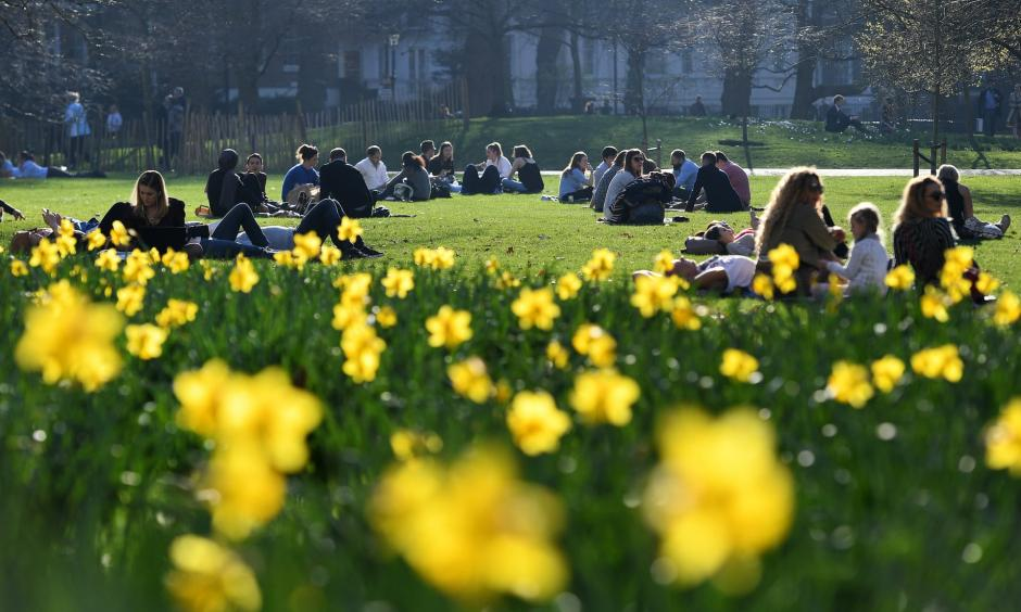 Park goers enjoy the warm winter weather in St. James's Park in London. The hottest winter day on record has been recorded in Britain for a second day running. Photo: Andy Rain, EPA