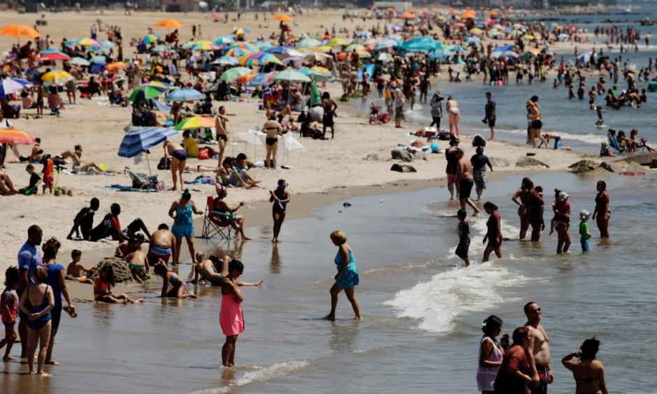 New Yorkers enjoy the beach in Coney Island. Photo: EPA