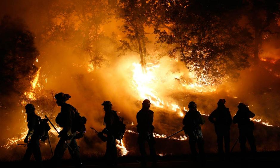 Firefighters battle the Valley Fire near Middletown, California, on September 13. Stephen Lam / Getty Images