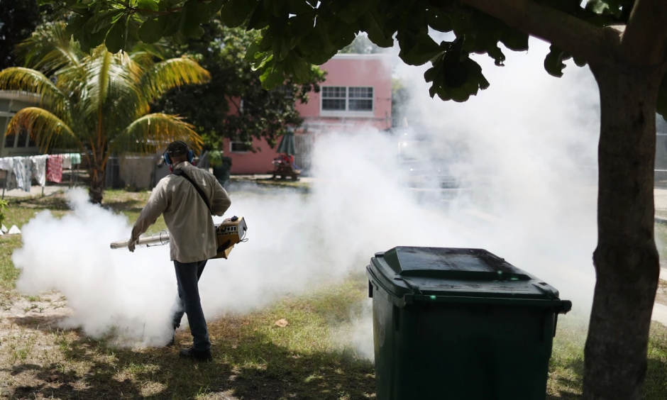 A Miami-Dade County mosquito control inspector sprays pesticide in the Wynwood neighborhood. Photo: Joe Raedle / Getty Images