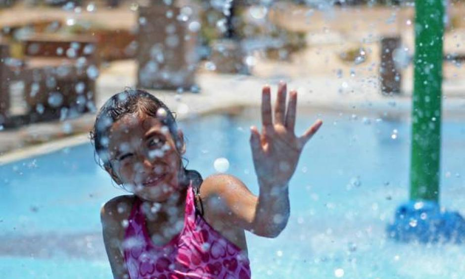Izebelh Pin-Torres plays at the Charlie Frias Park on Wednesday, July 1, 2015, in North Las Vegas. This past June was the hottest on record. Image:James Tensuan/Las Vegas-Review Journal