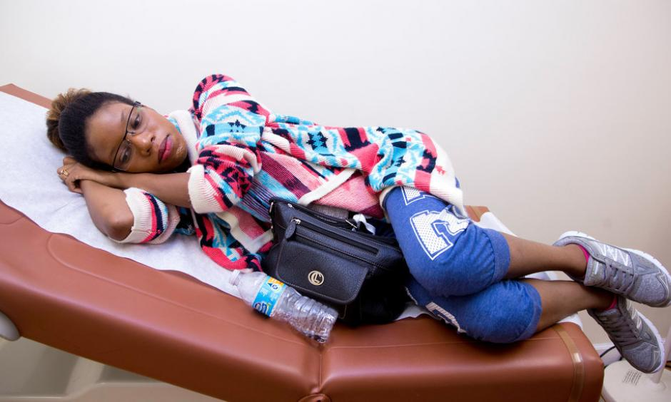 Unique Robinson, 22, of Hollywood, Fla., waits to be seen by her obstetrician, Dr. Aaron Elkin. Photo: Joshua Prezant for The New York Times