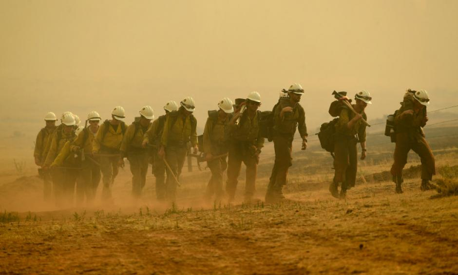 Members of the Craig Hotshots return to their crew cabs after a long day of fighting the Weston Pass Fire on July 2, 2018 near FairPlay. Credit: Helen H. Richardson, The Denver Post