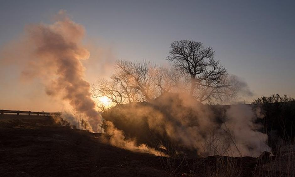 Smoke rises along US Route 160, west of Medicine Lodge, Kansas, following a wildfire that ravaged the area, March 26, 2016. The blaze, which has scorched nearly 400,000 acres, is said to be the largest recorded wildfire in the state's history and has prompted a vast mobilization of firefighters rarely seen in this state. Photo: Craig Hacker, The New York Times