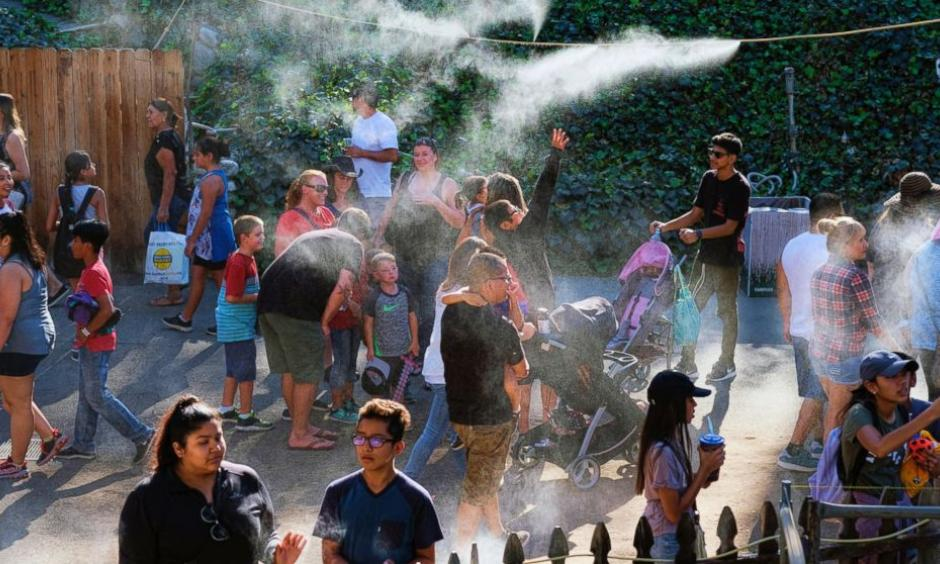 In this Saturday, Sept. 24, 2016 photo, visitors to the Los Angeles County fair cool off under outdoor misters in Pomona, Calif. Californians braced Monday, Sept. 26 for another hot autumn day as forecasters warned of soaring temperatures and potential wildfires due to hot, dry and windy conditions. Photo: Richard Vogel, AP