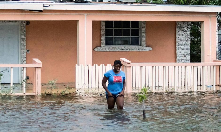 A woman walks in a flooded street after the effects of Hurricane Dorian arrived in Nassau, Bahamas. Photo: Reuters