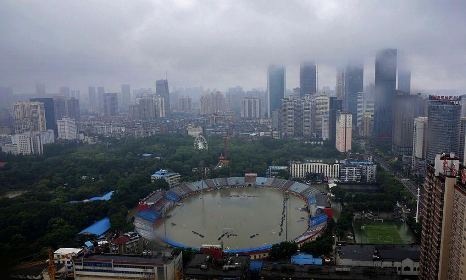 "A stadium in Wuhan, China on July 6, 2016, after the city received 7.09"" (180 mm) of rain in the twelve hours ending at 8 am July 6. Wuhan received over 560 mm (1.8 feet) of rain over the ten day period before the July 6 deluge, causing widespread damage and chaos. Photo: Wang He/Getty Images"