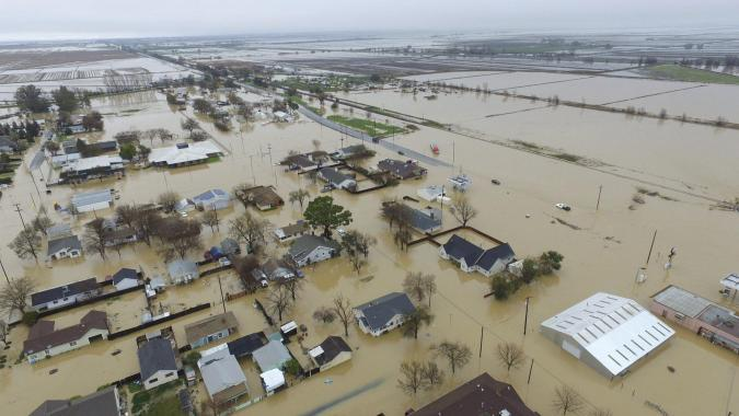 This Saturday, Feb. 18, 2017, aerial photo, shows major flooding in Maxwell, Colusa County, Calif. Water is receding in the farm community of Maxwell, where dozens of people sought higher ground after creeks topped their banks and inundated houses on Friday, said Colusa County Assistant Sheriff Jim Saso said. HECTOR INIGUEZ VIA AP