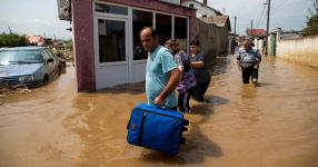 People fled their flooded homes Sunday in the village of Stajkovci, near Skopje, Macedonia. Photo: Robert Atanasovski/Agence France-Presse