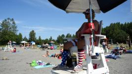 Lifeguard Luke Orot watches over swimmers at Jewel Lake on a hot July 4 in Anchorage. Photo: Lance King, Getty Images