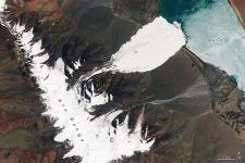 Photo shows the damage an ice avalanche in Tibet's Rutog county. Image: NASA Earth Observatory