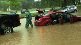 Cars abandoned along flooded road in Washington D.C. area. Photo: WJLA