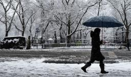 """A pedestrian walks in the morning snow during an early spring storm on April 2, 2018 in New York City. The daily snowfall total of 5.5"""" in Central Park was the heaviest for any April day since 1982 and the seventh heaviest one-day April snow in records going back to 1869. Photo: Spencer Platt, Getty Images"""
