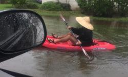 A resident kayaking on the flooded streets of Miami Beach on Tuesday. Photo: Nick Namias