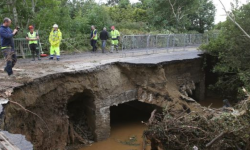 A collapsed road at Quigley's Point in Co Donegal after heavy rain left a trail of destruction. Photo: Niall Carson/PA Wire
