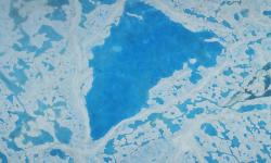 A large pool of meltwater over sea ice in the Beaufort Sea. Photo: NASA, Operation IceBridge